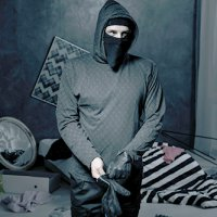 Masked thief in a messy dark room